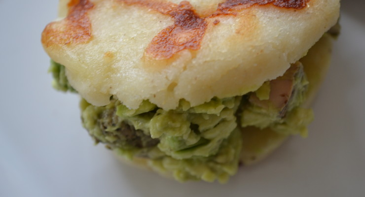 the reina pepiada is a simple arepa comprised with shredded slow ...