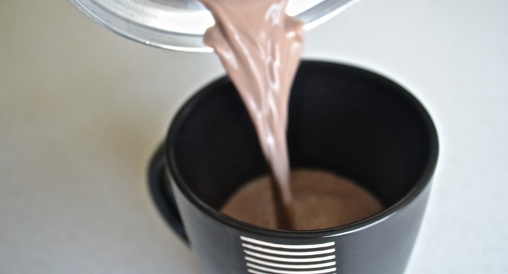 Pouring Colombian Hot Chocolate into a mug