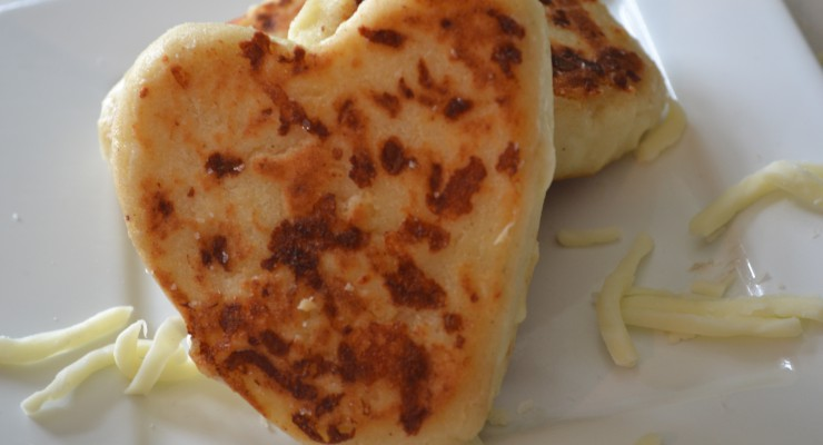 Heart shaped arepa on a plate